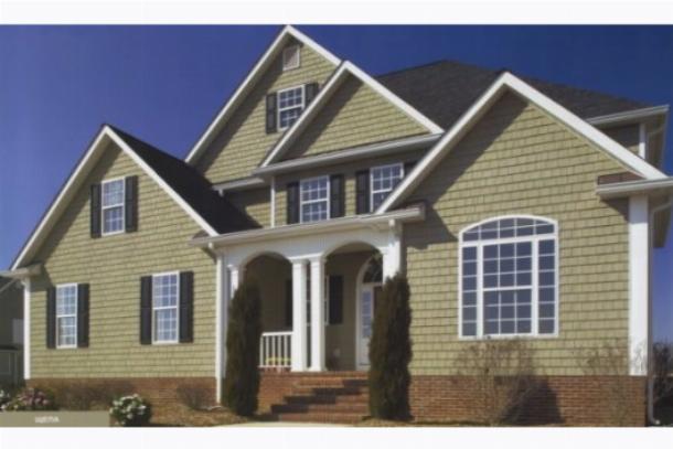 Дом, облицованный фасадными панелями под кирпич