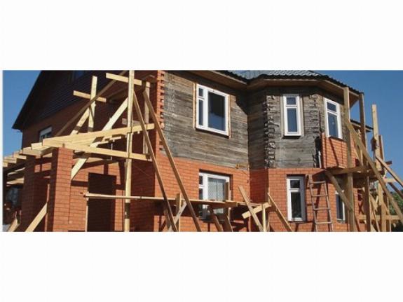 Как правильно обложить дом из бруса кирпичом?